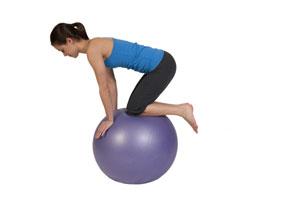 Single Arm Raise Balance Exercise on Exercise Ball